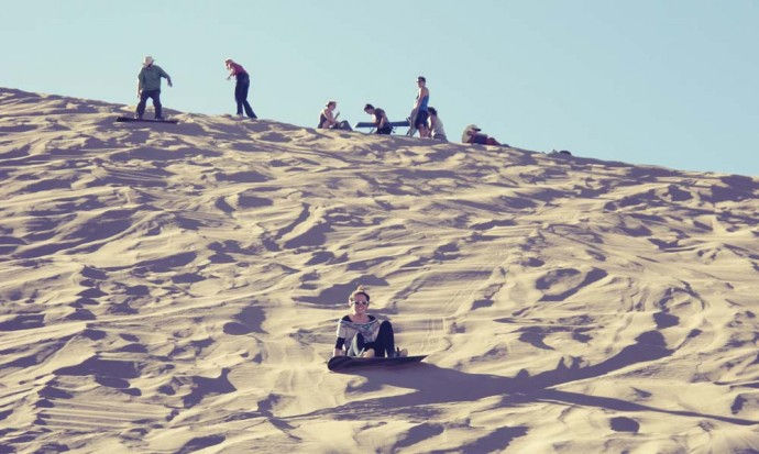 Victoria falling over sandboarding in San Pedro de Atacama