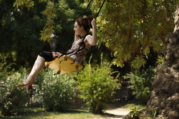 Victoria on a swing in Ciutadella Park