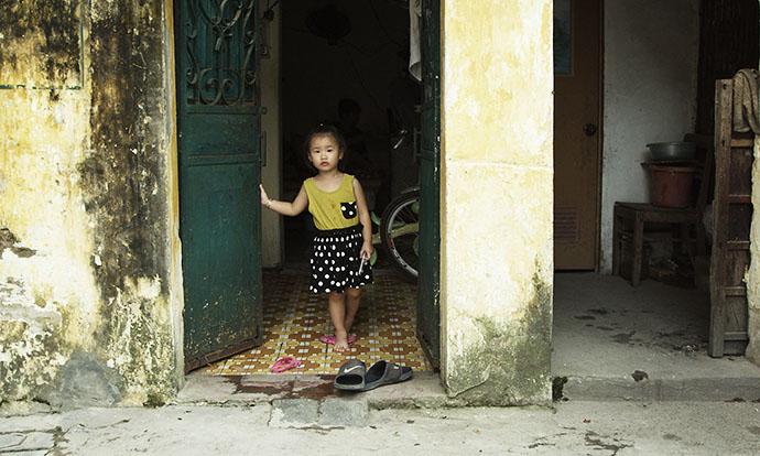 Girl in doorway in Continuum
