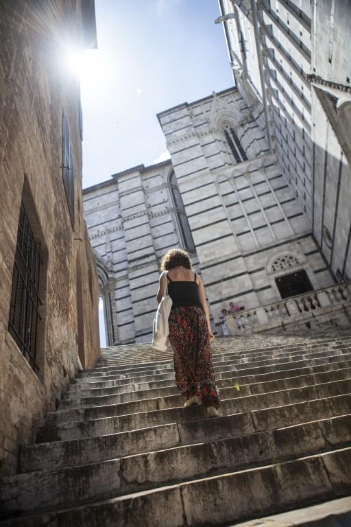 Victoria walking in Siena