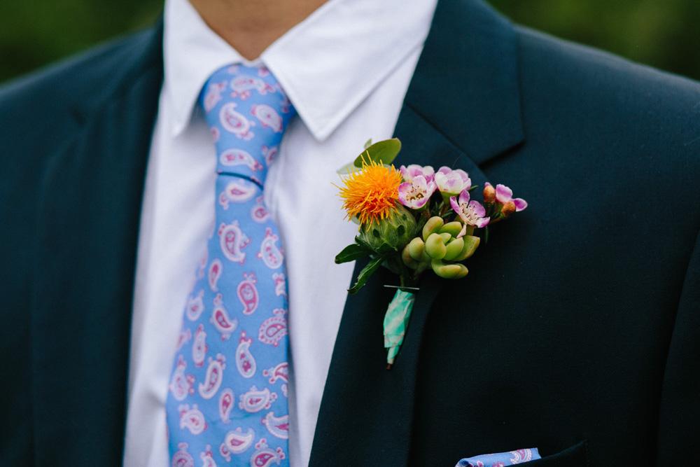 Succulent button holes for festival wedding